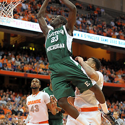 Eastern Michigan Eagles forward GLENN BRYANT (23) soars to the hoop while drawing the foul from Syracuse Orange forward DEJUAN COLEMAN (32) during the first half at the Carrier Dome in Syracuse, New York.