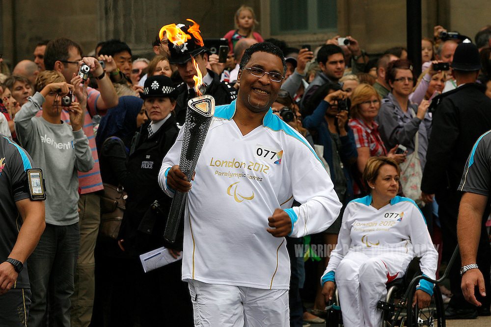 Paralympic torchbearer former boxer Michael Watson carries the Paralympic Torch in Trafalgar Square on August 29, 2012, in London, England. (Photo by Warrick Page)