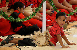 A child plays on the floor as children await the arrival of the Duke and Duchess of Sussex for a meeting with Tongan prime minister Akilisi Pohiva and his cabinet on the second day of the royal couple's visit to Tonga.