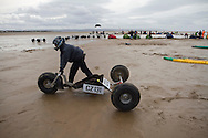 A buggy being wheeled out onto the course before one of the races at the European Kite Buggy Championships at Hoylake, Wirral, north west England. Around 75 buggies, with both male and female pilots, from 10 countries took part in the annual event which lasted from 5-9 September 2011. The three-wheeled, single-seated, steel frame buggy was powered  by a traction, or power kite and could achieve speeds of up to 70mph/110km/h.