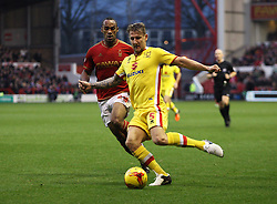 Kyle McFadzean of Milton Keynes Dons and Chris O'Grady of Nottingham Forest in action - Mandatory byline: Jack Phillips / JMP - 07966386802 - 19/12/2015 - FOOTBALL - The City Ground - Nottingham, Nottinghamshire - Nottingham Forest v MK Dons - Sky Bet Championship