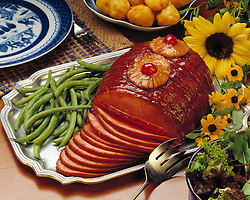Family style home cooked meal, spiral cut honey baked ham, pineapple cherry glaze, green salad, string beans, potatos.