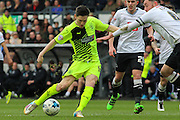 Huddersfield Town midfielder Joe Lolley strikes at goal during the Sky Bet Championship match between Derby County and Huddersfield Town at the iPro Stadium, Derby, England on 5 March 2016. Photo by Aaron Lupton.