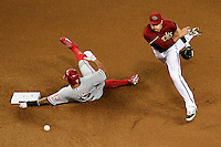 PHOENIX, AZ - AUG 12: D-backs infielder Nick Ahmed turns the double play over the sliding Phillies' Freddy Galvis in the fourth inning. (Photo by Jennifer Stewart/Arizona Diamondbacks)
