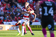 Doncaster Rovers forward Niall Ennis (31) and Peterborough United defender Frankie Kent (6) in action during the EFL Sky Bet League 1 match between Doncaster Rovers and Peterborough United at the Keepmoat Stadium, Doncaster, England on 21 September 2019.