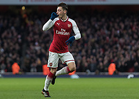 Football - 2017 / 2018 Premier League - Arsenal vs. Newcastle United<br /> <br /> Mesut Ozil (Arsenal FC) with a penny whistle in his mouth summons the other Arsenal players as he celebrates after scoring at The Emirates.<br /> <br /> COLORSPORT/DANIEL BEARHAM