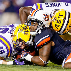 Sep 21, 2013; Baton Rouge, LA, USA; Auburn Tigers wide receiver Quan Bray (4) recovers a fumble from LSU Tigers linebacker Seth Fruge (48) during the second half of a game at Tiger Stadium. LSU defeated Auburn 35-21. Mandatory Credit: Derick E. Hingle-USA TODAY Sports