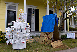 21st, December 2005. New Orleans Christmas decorations. Uptown, Penniston Street. A humerous refrigerator Christmas tree. Refrigerators litter the city following Hurricane Katrina where food sat rotting for weeks and months with no power, here a resident tries to inject a little humour into the season.