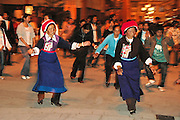 China, China, Yunnan province, Zhongdian, AKA Shangri-La People in traditional dress folk dance in the main square