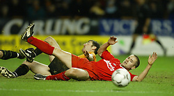 WOLVERHAMPTON, ENGLAND - Wednesday, January 21st, 2004: Liverpool's Michael Owen misses a chance under pressure from Wolverhampton Wanderers' Denis Irwin during the Premiership match at Molineux. (Pic by David Rawcliffe/Propaganda)