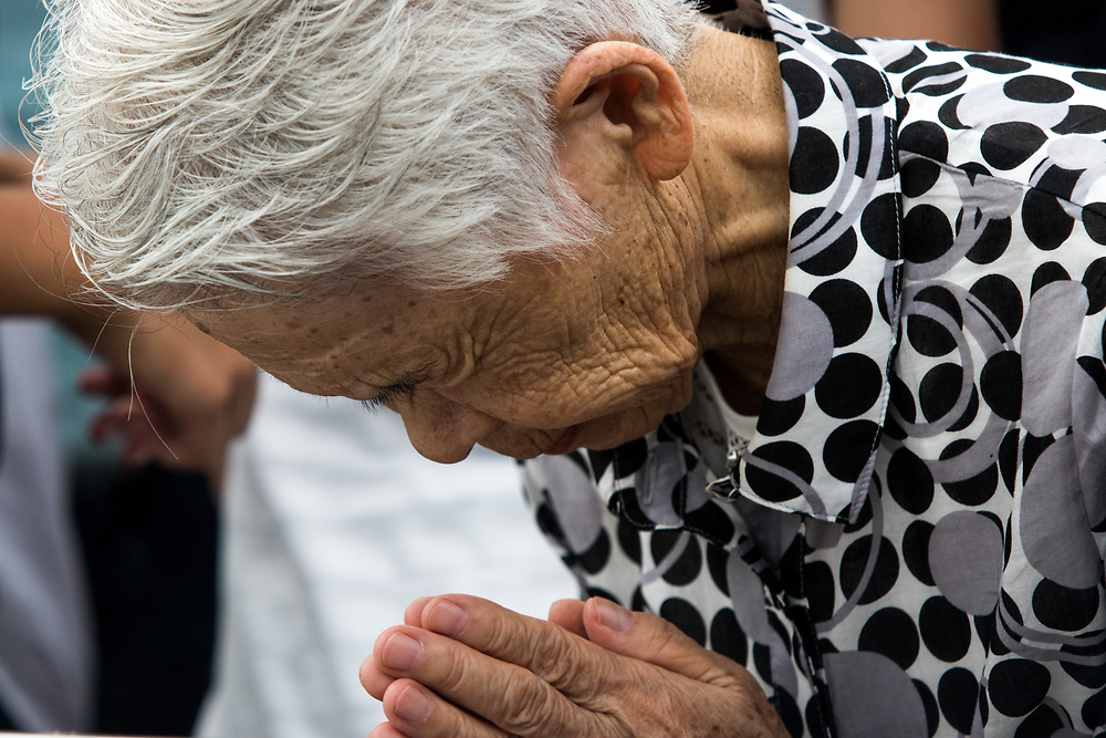 NAGASAKI, JAPAN - AUGUST 9 : Visitors pray for the atomic bomb victims in front of the Nagasaki Peace Park in Nagasaki, southern Japan on Wednesday, August 9, 2017. Japan marked the 72nd anniversary of the atomic bombing on Nagasaki. (Photo: Richard Atrero de Guzman/AFLO)