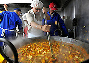 WATFORD HERTFORDSHIRE: A man prepares some of the 60thousand meals handed out free to visitors. Over 55,000 pilgrims and guests visit the Largest Hindu Festival in Europe at Bhaktivedanta Manor Krishna Temple near Watford on Sunday 5th September to celebrate Janmashtami the birth of Lord Krishna. The Manor was donated to the Hare Krishna Movement in the early 1970s by former Beatle George Harrison. 03 SEPT 2010. STEPHEN SIMPSON ..