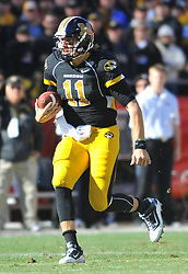 Nov 27, 2010; Kansas City, MO, USA; Missouri Tigers quarterback Blaine Gabbert (11) runs for yardage in the first half of the game against the Kansas Jayhawks at Arrowhead Stadium. Missouri won 35-7.  Mandatory Credit: Denny Medley-US PRESSWIRE