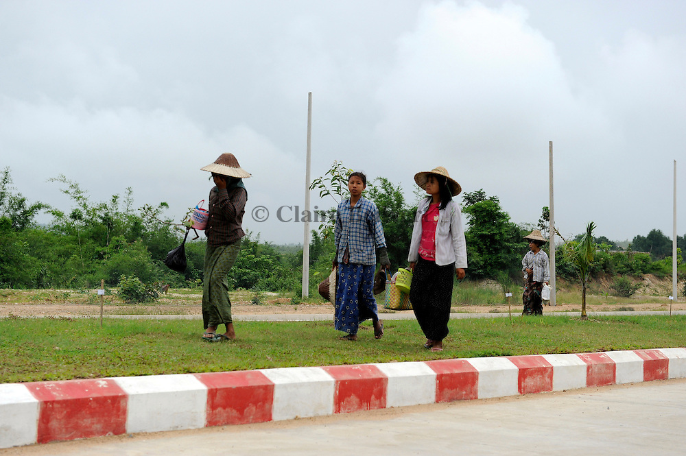 Women forced to work in Naypyidaw. They have to bring their own food. They sometimes get a paltry wage, around $1 per day. Even old women have to work.