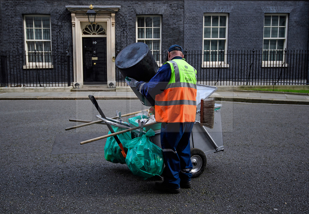 © Licensed to London News Pictures. 30/03/2017. London, UK. A Westminster Council street cleaner seen emptying the bins on Downing Street on March 30, 2017 Photo credit: Ben Cawthra/LNP