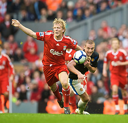 LIVERPOOL, ENGLAND - Sunday, October 25, 2009: Liverpool's Dirk Kuyt is deliberately fouled by Manchester United's Nemanja Vidic, who was shown a second yellow card and sent off, during the Premiership match at Anfield. (Photo by David Rawcliffe/Propaganda)