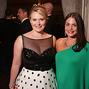 Elle Woods, left, and Nicole Massimino pose for a picture Saturday December 6, 2014 during the 9th Annual Wilmington Fur Ball at the Country Club of Landfall in Wilmington, N.C. (Jason A. Frizzelle)