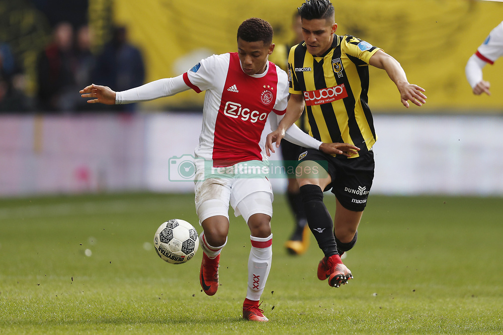 (L-R) David Neres of Ajax, Navarone Foor of Vitesse during the Dutch Eredivisie match between Vitesse Arnhem and Ajax Amsterdam at Gelredome on March 04, 2018 in Arnhem, The Netherlands