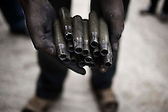 SYRIA, Idlib province: A Syrian man shows bullet cases found in Taftanaz, on April 11, 2012. ALESSIO ROMENZI