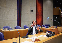 Nederland. Den Haag, 19 mei 2011.<br /> Minister-president Mark Rutte belt voor hervatting van het debat in vak K en wil even niet gestoord worden.<br /> Verantwoordingsdag. Debat in de Tweede Kamer. Het kabinet legde tijdens dit debat verantwoording af over het gevoerde beleid tegenover de fractievoorzitters.<br /> Foto : Martijn Beekman