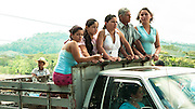 A family travels in a truck, Quepos, Costa Rica.