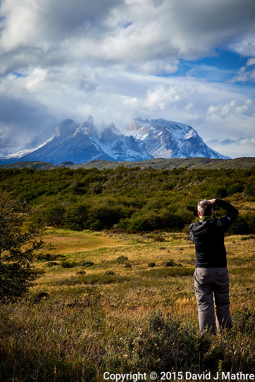 Photographer at Work. Sky, Clouds, and Mountains in Torres del Paine National Park. Image taken with a Fuji X-T1 camera and Zeiss 32 mm f/1.8 lens.