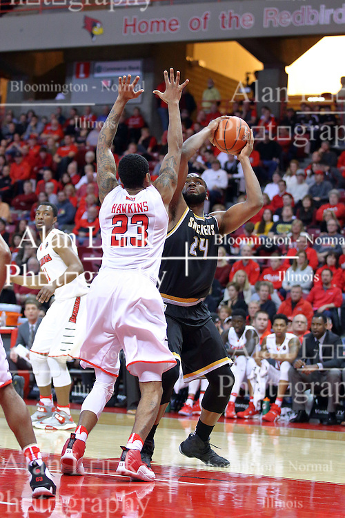14 January 2017:  Shaquille Morris leans backward a bit to line up a shot over Deontae Hawkins(23) during an NCAA  MVC (Missouri Valley conference) mens basketball game between the Wichita State Shockers the Illinois State Redbirds in  Redbird Arena, Normal IL