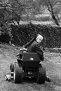 """Sister Leonida, a nun since 1945, cuts the """"lawn of paradise"""" at Sisters of Saint Basil The Great Tuesday May 1, 1990 in Jenkintown, Pennsylvania. (Photo by William Thomas Cain/Cain Images)"""