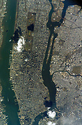 2005. Manhattan Island and its easily recognizable Central Park are featured in this image photographed by an Expedition 10 crewmember on the International Space Station. Some of the other New York City boroughs (including parts of Queens and Brooklyn) are also shown, as are two small sections of the New Jersey side of the Hudson River (left)