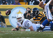 Indianapolis Colts Andrew Luck watches the ball get away from him after he is sacked by Pittsburgh Steelers James Harrison in the second quarter. The Colts recovered the ball. Indianapolis traveled to Pittsburgh Sunday, October 26, 2014.