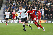 Derby County defender Richard Keogh and Cardiff City striker Kenwyne Jones challenge for the ball during the Sky Bet Championship match between Derby County and Cardiff City at the iPro Stadium, Derby, England on 21 November 2015. Photo by Aaron Lupton.