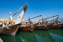 Traditional dhow fishing boasts in fishing harbour at Nag'aat Al Kout in Fahaheel , Kuwait, Middle East.