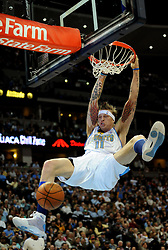 2009 FEB 2-Denver's Chris Andersen dunks the ball past the San Antonio defense at the Pepsi Center Tuesday night. (special to the Rocky/Joshua Duplechian)