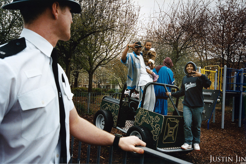Africans at a playground greet a white policeman patroling a predominantly Somalian Neighbourhood in Leicester city. ..Leicester has a large Somali population after thousands of them migrated en mass from the Netherlands. ..Leicester is expected to be the first city in the UK to have a majority non-white population within the next few years. It is one of the most ethnically-diverse cities in Europe. ....Picture taken April 2005 by Justin Jin