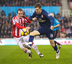 STOKE-ON-TRENT, ENGLAND - Saturday, February 27, 2010: Arsenal's Aaron Ramsey and Stoke City's Danny Pugh during the FA Premier League match at the Britannia Stadium. (Photo by David Rawcliffe/Propaganda)