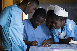 2 November 2019, Ganta, Liberia: Nurses inspect the hematocrit level in a blood sample in the Ganta Hospital lab. Located in Nimba county, the Ganta United Methodist Hospital serves tens of thousands of patients each year. It is a founding member of the Christian Health Association of Liberia.