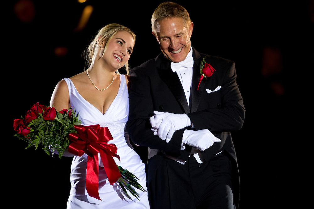 Caption:(Wednesday 12/28/2011 St. Petersburg) Mary O'Conner Smith smiles at her father, Raymond Paul Smith III, as he escorts her during the Presentation Ball, hosted by the St. Petersburg Debutante Club. The annual event, which began in 1937, was held at The Colisuem in St. Petesburg on Wednesday Dec. 28, 2011...Summary:The Presentation Ball, hosted by the St. Petersburg Debutante Club. ..Photo by James Branaman