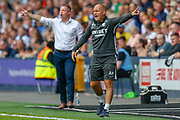 Millwall manager Neil Harris and Preston North End manager Alex Neil pointing, directing, signalling during the EFL Sky Bet Championship match between Millwall and Preston North End at The Den, London, England on 3 August 2019.