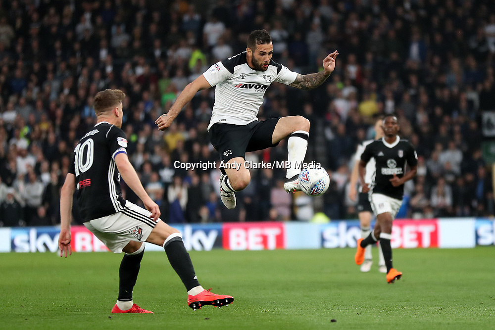 DERBY, ENGLAND - MAY 11: - DCFC vs Fulham. Bradley Johnson, goes past a defender
