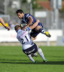 Bedford Blues' Luke Baldwin tackles Bristol Rugby's Marco Mama - Photo mandatory by-line: Joe Meredith/JMP - Tel: Mobile: 07966 386802 06/10/2013 - SPORT - FOOTBALL - RUGBY UNION - Memorial Stadium - Bristol - Bristol Rugby V Bedford Blues - The Championship