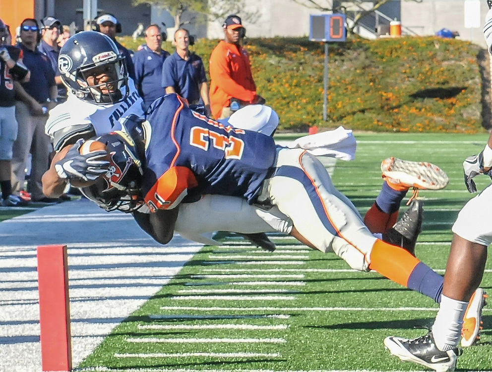 11/5/16 3:44:05 PM Fullerton Hornet wide receiver Daurice Simpson (89) is tackled Orange Coast Pirate defensive back Kyre Adams (31) near the end zone during the fourth quarter. Fullerton College v Orange Coast College Football, at LeBard Stadium on the campus of Orange Coast College in Costa Mesa, CA<br /> <br /> Photo by Joshua D. McKee