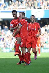 Liverpool's Raheem Sterling, Steven Gerrard and Liverpool's Jose Enrique celebrate after Steven Caulker's own goal - Photo mandatory by-line: Dougie Allward/JMP - Mobile: 07966 386802 - 19/10/2014 - SPORT - football - London - Loftus Road - QPR v Liverpool - Barclays Premier League
