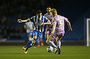 Brighton winger, Jamie Murphy (15) takes on Reading defender Paul McShane (5) during the Sky Bet Championship match between Brighton and Hove Albion and Reading at the American Express Community Stadium, Brighton and Hove, England on 15 March 2016.