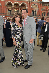 DAME JOAN COLLINS and PERCY GIBSON at the V&A Summer Party in association with Harrod's held at The V&A Museum, London on 22nd June 2016.