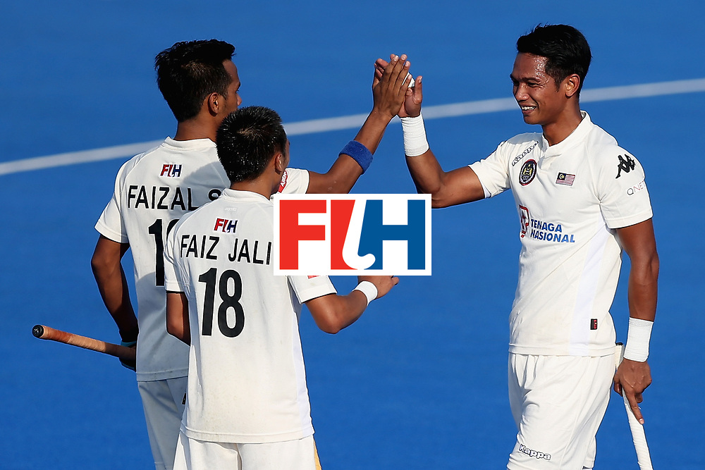 LONDON, ENGLAND - JUNE 20:  Razie Rahim of Malaysia celerates scoring his sides fourth goal with Faiz Jali of Malaysia and Faizal Saari of Malaysia during the Pool A match between China and Malaysia on day six of the Hero Hockey World League Semi-Final at Lee Valley Hockey and Tennis Centre on June 20, 2017 in London, England.  (Photo by Alex Morton/Getty Images)