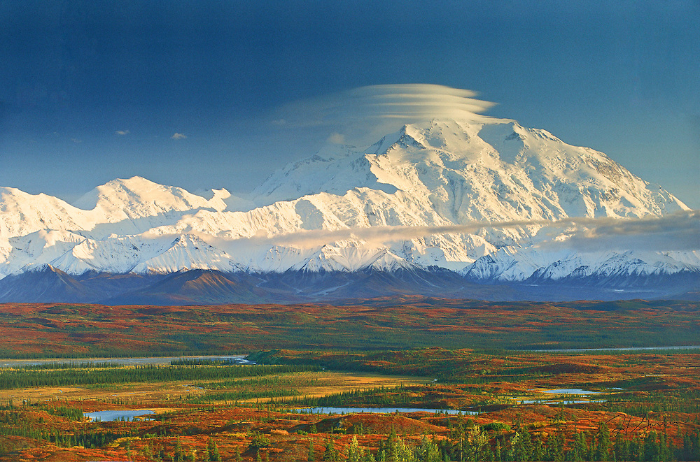 AKS-6  Denali (Mount McKinley) and autumn foliage, Denali National Park, Alaska.  Lenticular Cirrus Cloud indicates high winds aloft and approaching storm.   Original:  35mm Transparency.
