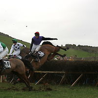 Hold on tight....D.T. Stratton did well to hold to his horse That's Not Fair  as she had a slight stumble at this fence behind the winner Moscow's Dream at the Bellhabour point to point last weekend.<br />