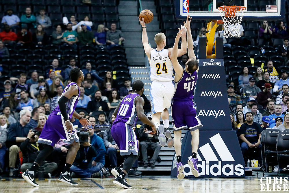 06 March 2017: Denver Nuggets center Mason Plumlee (24) goes for the baby hook against Sacramento Kings center Kosta Koufos (41) during the Denver Nuggets 108-96 victory over the Sacramento Kings, at the Pepsi Center, Denver, Colorado, USA.