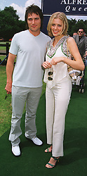 Actress DONNA AIR and MR RICK DUCE at a polo match in Berkshire on 13th June 1999.MTD 27