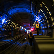 December 12, 2016 - New York, NY :  From left, Gilberto Almonte and Mike Vigna walk along the tracks, in the tunnel between the 86th and 96th Street Second Avenue subway stations on Monday morning. After years of delays, the new subway line is preparing to welcome its first straphangers. CREDIT: Karsten Moran for The New York Times